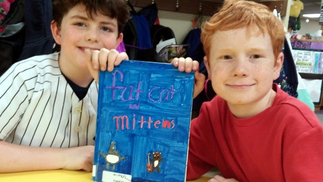 Webster Schlegel Elementary School fourth graders Chase Clemens and Wyatt Rowley with their new book.