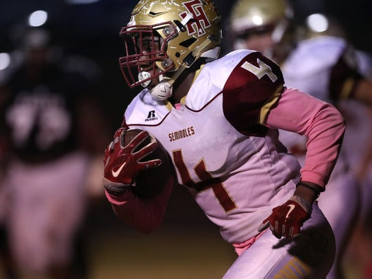 Florida High's Kevin Sawyer came up big on offense and defense in a 28-27 overtime playoff win at Fort White last week.