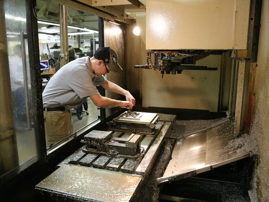Josh Hensel sets up a milling machine at Monsees Tool