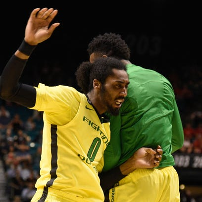 March 12, 2015; Las Vegas, NV, USA; Oregon Ducks forward Dwayne Benjamin (0) celebrates against the Colorado Buffaloes during the second half in the quarterfinal round of the Pac-12 Conference tournament at MGM Grand Garden Arena. The Ducks defeated the Buffaloes 93-85. Mandatory Credit: Kyle Terada-USA TODAY Sports