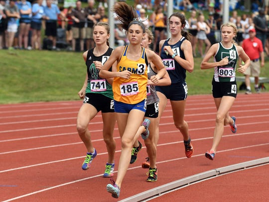 Carmel's Phoebe Bates leads a pack of runners in the