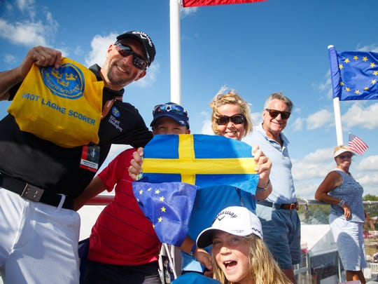 A group from SwedenÊcheer for the European team during the opening ceremony for the 2017 Solheim Cup Thursday, Aug. 17, 2017.