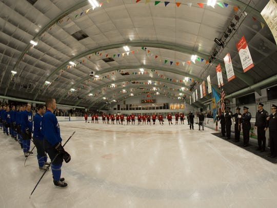 Wilmington police and firefighter hockey teams line up for pregame ceremonies at the Winter Classic.