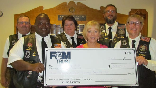 Chambersburg's American Legion Riders present a donation to the Cumberland Valley Breast Care Alliance. Left to right, in the front row, Phil Campbell, ALR Post 46 president; Sharon Brosious from the CVBCA; Carol Lemaster, ALR secretary.  In the back row, Gary Comfort, vice-president; Linda Comfort, treasurer; and Glenn Lemaster, road captain.