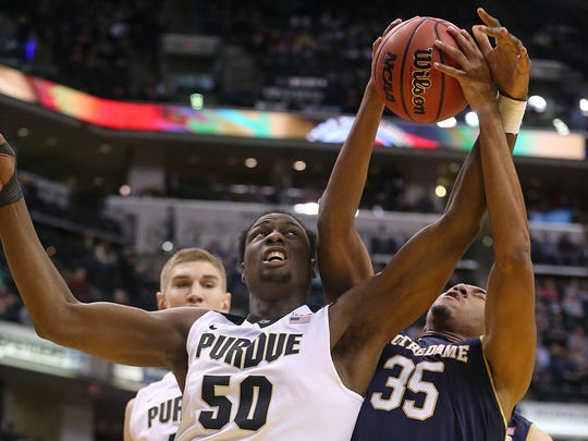 Notre Dame Fighting Irish forward Bonzie Colson (35) takes the ball from Purdue Boilermakers forward Caleb Swanigan (50) during first half action of the Crossroads Classic between Notre Dame and Purdue at Bankers Life Fieldhouse in Indianapolis, Saturday, Dec. 17, 2016.