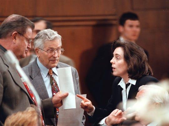 Sen. Eugene Timms (left), and Senate Majority Leader Gene Derfler listen to Senate Minority Leader Kate Brown on the Senate floor in 1998.