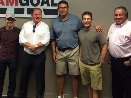 Charlotte Panthers head coach Ron Rivera (center) with