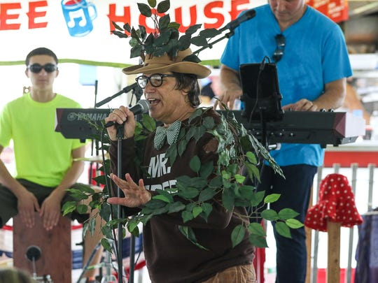 "Jeff Michalowski sings as ""The Tree Song"" as a member of the band Joy and the Toys at the Morris County 4H Fair at Chubb Park in Chester on July 18, 2015. At left is Zach Boettcher on drums and right is Alan Boettcher on keyboards."