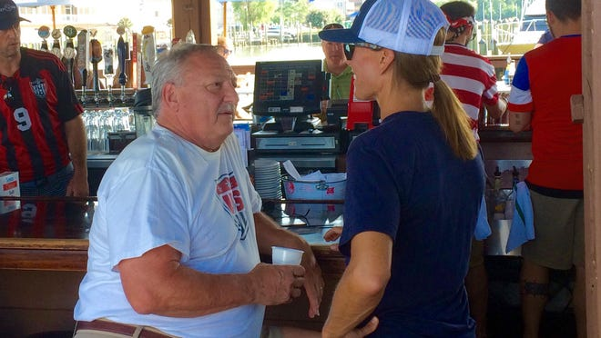 Tisha Venturini-Hoch meets and talks with an older fan at Brew River