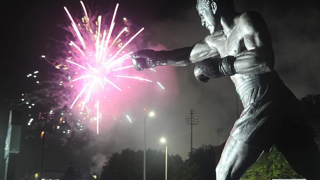 In a July 12, 2019, file photo, the Rocky Marciano statue frames fireworks launched after the Brockton Rox game at Campanelli Stadium.