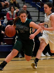 Junior Kayla Nelson (13), who finished with eight points, gets past Berkley defender Cara Hall Thursday evening.