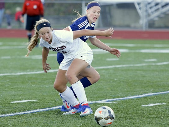 Elmira's Alexus Boorse tries to hold off Riley Peterson