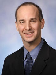 Andy Schor, a Democratic state representative, takes office Jan. 1 as Lansing's next mayor.