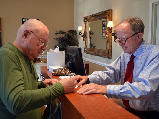 Life long Stein Jewelry customer Boyd Shaw, left, is assisted by store owner Jim Russell. Stein Jewelry, located at 1896 Main St. in Madison will be closing their doors so the owners can retire.