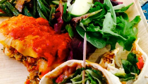 Lasagne; green beans with mushroom; fennel, green apple and cranberry salad; breakfast burrito.