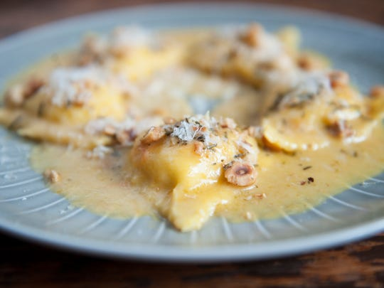 Ricotta ravioli with butternut squash sauce, rosemary and hazelnuts at The Love in Philadelphia.