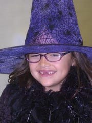 Haley Sherman, 5, dresses up as a witch for the annual Bingham Boo.