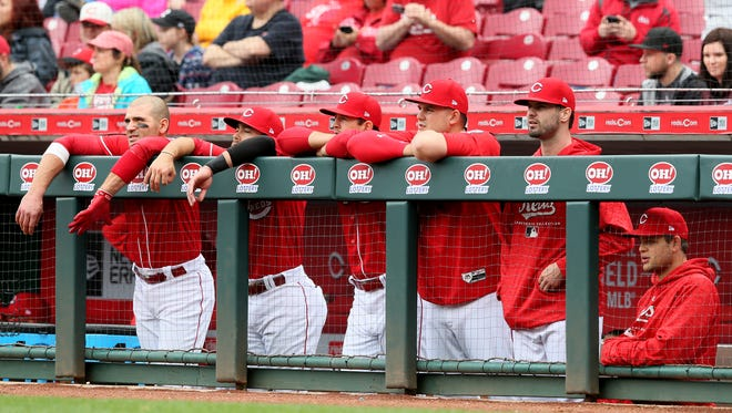 From left: Cincinnati Reds first baseman Joey Votto (19), shortstop Alex Blandino (2), starting pitcher Tyler Mahle (30), starting pitcher Sal Romano (47), right fielder Jesse Winker (33) and catcher Devin Mesoraco (39) watch the game in the ninth inning during the National League baseball game between the St. Louis Cardinals and the Cincinnati Reds, Saturday, April 14, 2018, at Great American Ball Park in Cincinnati. Cincinnati lost 6-1.