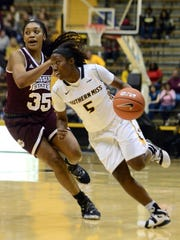 Southern Miss' Shonte Hailes dribbles past No. 5 Mississippi