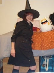 Jen Todd celebrates a past Halloween dressed as a witch.