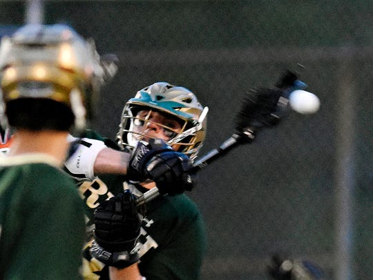 York Catholic's Cole Witman, back left, scores a goal