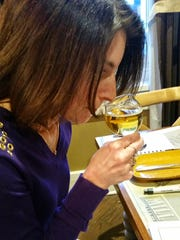 Debbie Gioquindo, aka Hudson Valley Wine Goddess, tests the aroma of a beer during the event at Mill House Brewing Company.