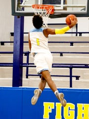 Jaemyn Brakefield finishes a windmill dunk for Huntington