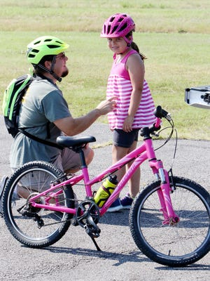 Jerry Schaberg of Van Buren, shares a few riding tips with his daughter, Emma, 7, Thursday, June 17, 2020, before riding the trails in Ben Geren Regional Park.