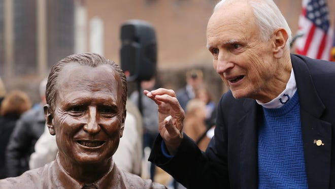 Former Indianapolis Mayor Bill Hudnut jokes with friends about the sculpture of his likeness unveiled at Hudnut Commons at Maryland and Capitol Ave. Sunday, December 14, 2014. Hudnut served at mayor of the city for 16 years.