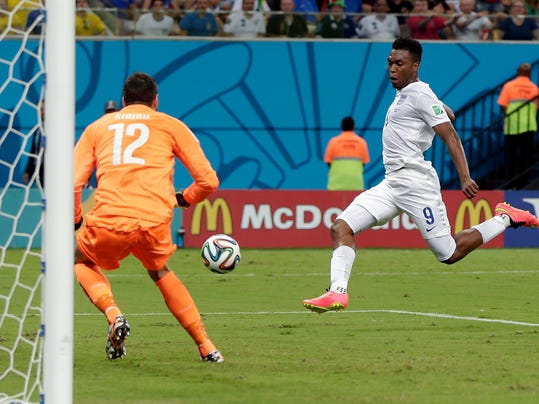 England's Daniel Sturridge (9) scores against Italy's goalkeeper Salvatore Sirigu (12) for England's first goal during the group D World Cup soccer match between England and Italy at the Arena da Amazonia in Manaus, Brazil, Saturday, June 14, 2014.  (AP Photo/Marcio Jose Sanchez)