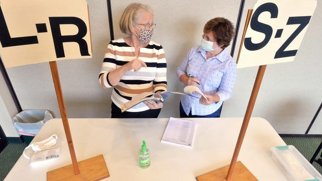 Linda Rummel, left, the elected judge of elections in Washington Township, talks with poll worker Becky Okel on Wednesday about the upcoming election.
