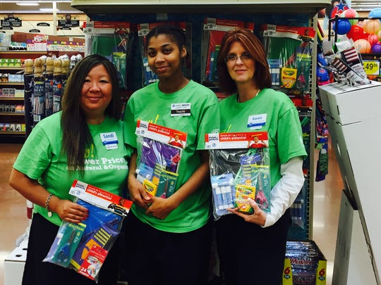 Sandi Dees, far left, with Price Hill Kroger associates at an in-store Crayons to Computers fundraiser in June. Crayons to Computers is one of Dees's many community involvement activities.