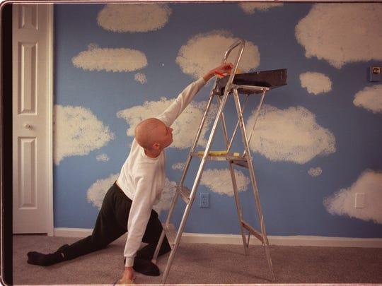 Clouds float across Alana's nursery walls. Pullins