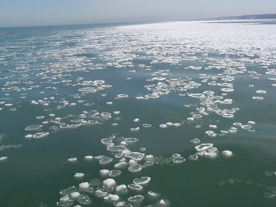 Pancake ice and ice balls appear on the water in the