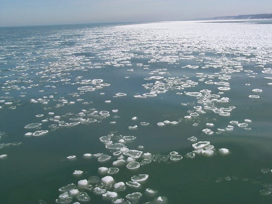 Pancake ice and ice balls appear on the water in the St. Joseph channel on Lake Michigan on Feb. 18, 2000.