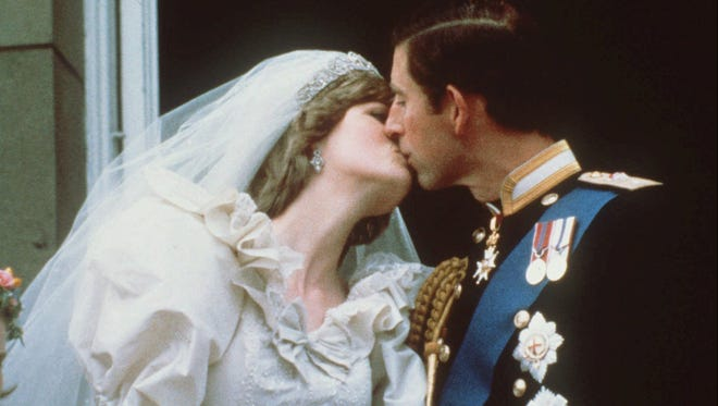 Britain's Prince Charles kisses Princess Diana on the balcony of Buckingham Palace in London after their wedding, in this July 29, 1981, file photo.