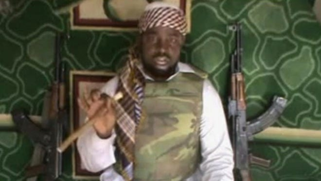 A photo taken from video posted by Boko Haram sympathizers shows the leader of the radical Islamist sect Imam Abubakar Shekau.