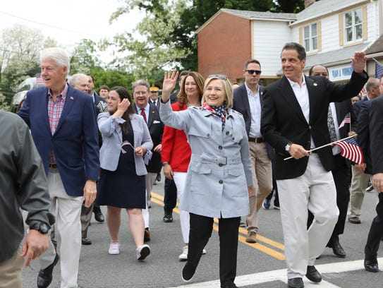 Bill and Hillary Clinton and Gov. Andrew Cuomo march