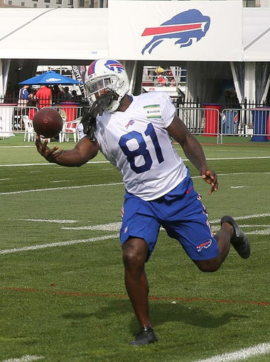 Newly acquired Buffalo Bills receiver Anquan Boldin makes a catch during passing drills at NFL football training camp in Pittsford, N.Y., Tuesday, Aug. 8, 2017.