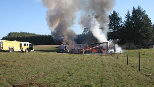 A fire south of Stayton destroyed a shop and two RVs and a boat that were stored at the site.