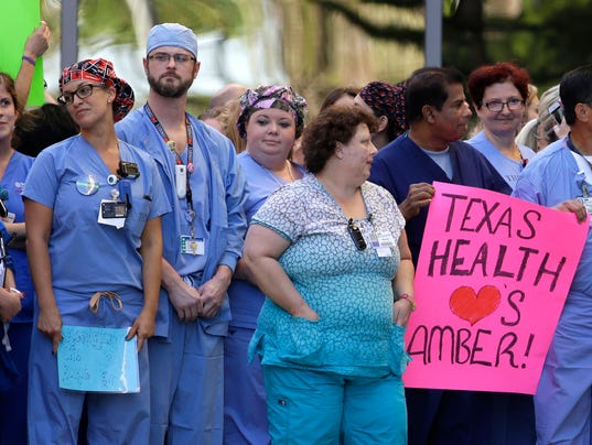 Travel ban for Texas health care workers in Ebola case
