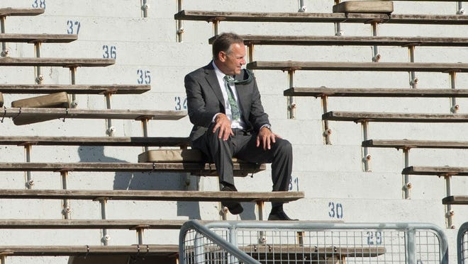 Michigan State coach Mark Dantonio sits in the stands at Notre Dame Stadium on Sep 17, 2016.