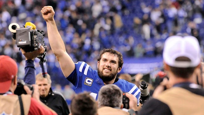 Indianapolis Colts quarterback Andrew Luck celebrates after defeating the Kansas City Chiefs 45-44 in the 2013 AFC wild card playoff football game at Lucas Oil Stadium.