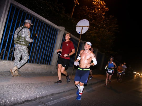7 marathons, 7 continents, 7 days: Knoxville resident Brian Winter completed that feat this year becoming one of only several hundred runners to ever finish the World Marathon Challenge. Here he is running in Cartagena, Colombia, with friend Andrew Brooks.