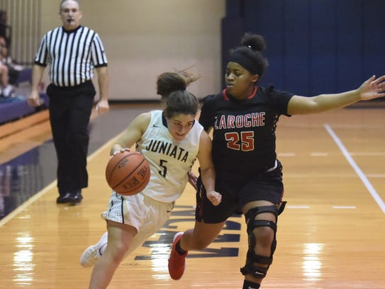 York Suburban High School graduate Bethany Spencer, left, is seen here in action for the Juniata College women's basketball team. PHOTO COURTESY OF JUNIATA COLLEGE