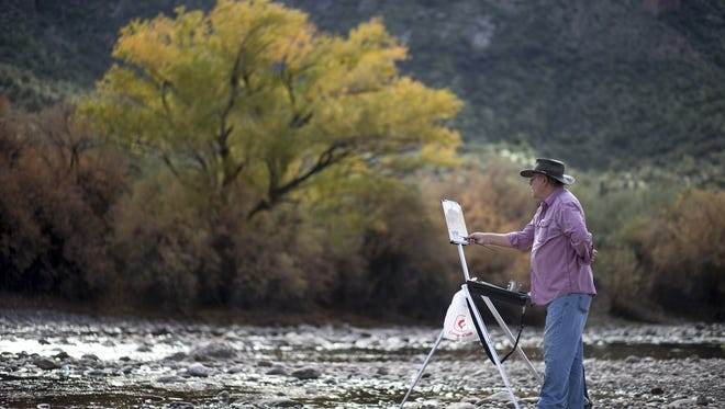Mel Peifer of Mesa paints on Jan. 3, 2017, at the Water Users Recreation Area, Tonto National Forest.