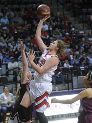 Hermleigh's Makia Gonzales drives to the basket against