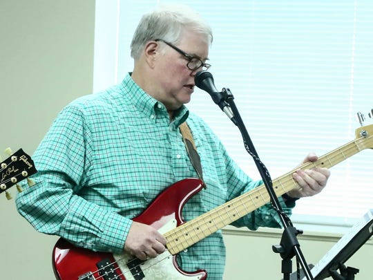 Stroke survivor Don Mann performs a guitar solo during a concert Friday, May 20, 2016, in the Connor Building at CareÕs Spring side Plaza in Newark.