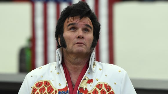 Paige Pool of Nevada, dressed as Elvis Presley, watches