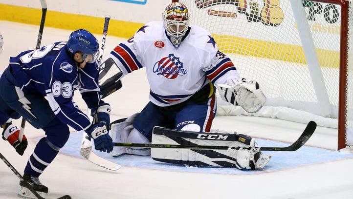Rochester goalie Linus Ullmark slide across the crease